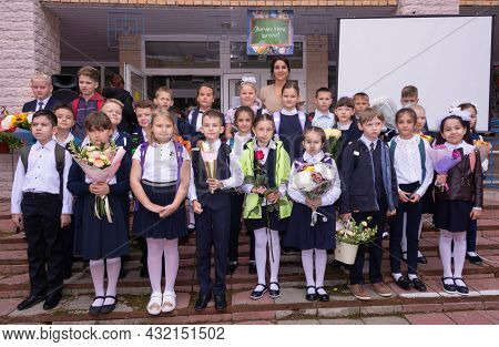 Korolev, Russia - September 1, 2021. Knowledge Day. September 1. Beautiful And Elegant Primary Schoo