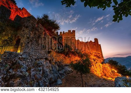 Beautiful castle on the hill in Alanya city at sunset. Turkey