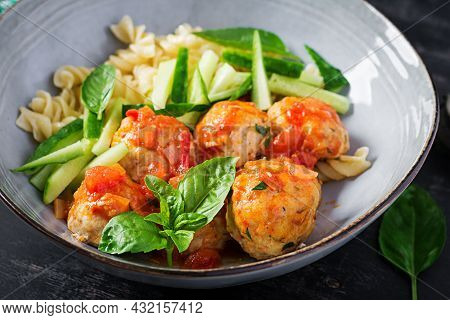 Italian Pasta. Fusilli With Meatballs, Cucumber And Basil On Dark Background. Dinner. Slow Food Conc