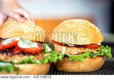 Cooking Delicious Homemade Burgers With Cutlet, Salad, Tomato And Sesame Burger Bun, Close-up. Delic