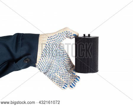 An Auto Mechanic Holds In His Hand An Old Dirty Oil Filter On A White Background, Isolate. Car Oil A