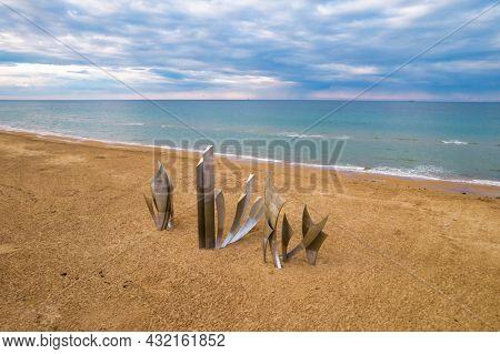 Omaha Beach, France - August 03, 2021 : Omaha beach metal artistic sculpture memorial of the WW II usa battle , Normandy, France