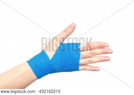 Blue Elastic Bandage On The Wrist Joint Of The Hand On A White Background, Isolate. Concept Of Wrist