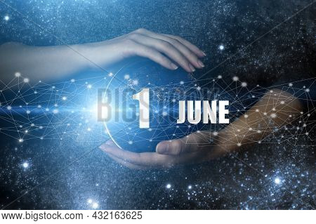 June 1st . Day 1 Of Month, Calendar Date. Human Holding In Hands Earth Globe Planet With Calendar Da