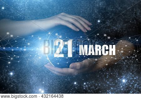 March 21st . Day 21 Of Month, Calendar Date. Human Holding In Hands Earth Globe Planet With Calendar