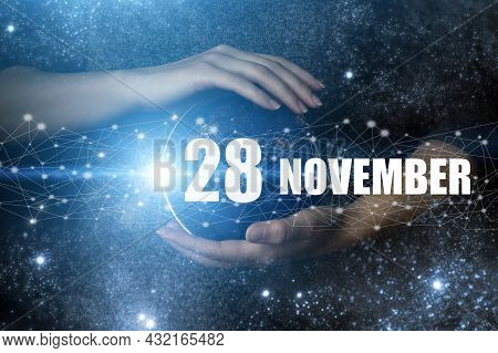November 28th. Day 28 Of Month, Calendar Date. Human Holding In Hands Earth Globe Planet With Calend