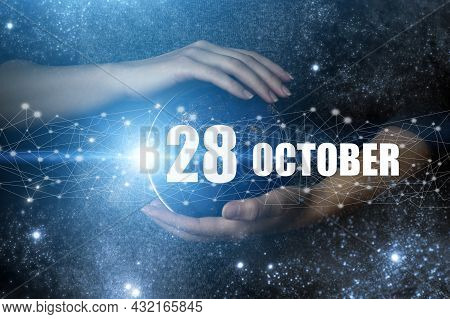 October 28th. Day 28 Of Month, Calendar Date. Human Holding In Hands Earth Globe Planet With Calenda