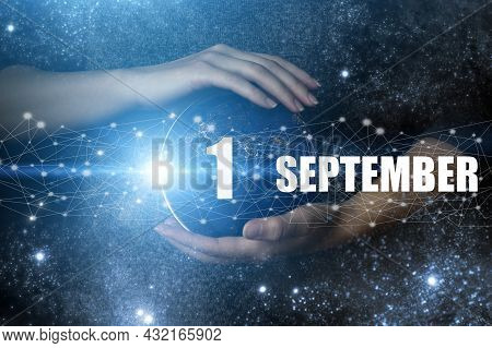 September 1st . Day 1 Of Month, Calendar Date. Human Holding In Hands Earth Globe Planet With Calend