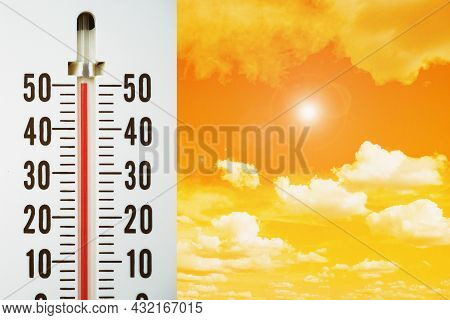 Closeup Thermometer Showing Temperature In Degrees Celsius, Hot Temperature With Lens Flare Effect