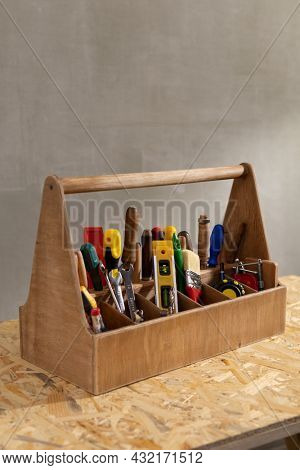 Construction tools and toolbox on wooden table background texture. Tools kit and tool box