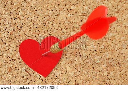 Dart Arrow Hitting In A Red Heart On Pinboard - Concept Of Love