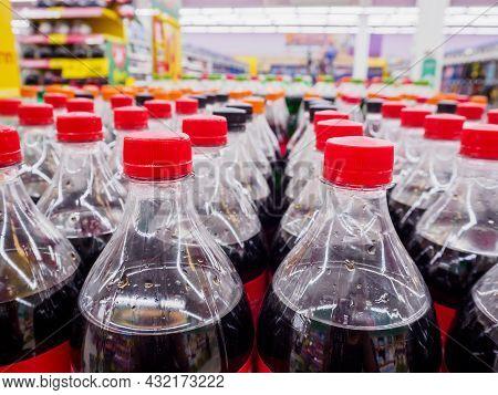 Carbonated Soft Drink Bottles Close Up In Supermarket