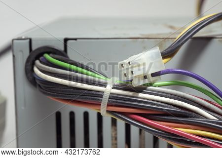 Computer Atx Non-modular Power Supply Unit Front Side. Outdated Power Connectors Of Pc Drives And Ma