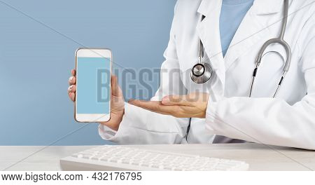 Doctor Holding A Mockup Smartphone With An Medical App