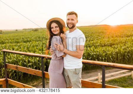 Charming Smiling Man Gently Hugging Attractive Woman, Enjoying Happy Moments. Joyful Beautiful Young