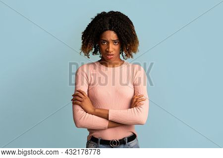 Portrait Of Offended Young African American Woman Standing With Folded Arms