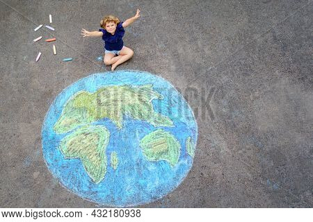 Little Preschool Girl With Earth Globe Painting With Colorful Chalks On Ground. Positive Toddler Chi