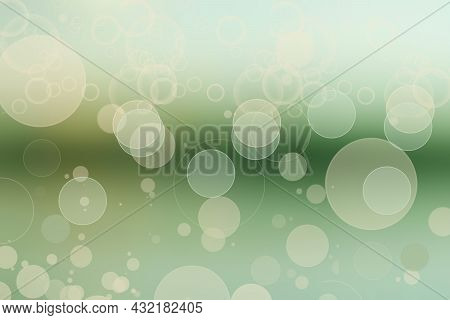 Abstract Gradient Green Light Turquoise Shiny Blurred Background Texture With Circular Bokeh Lights.