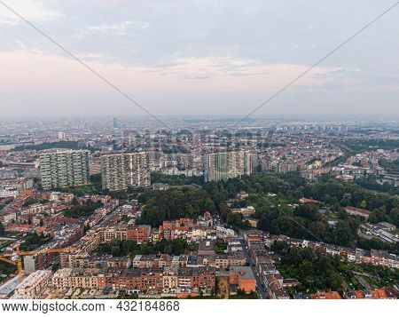 Aerial panorama view of Brussels-Capital Region and suburban area in the foreground. View from Ganshoren municipality during grey sunset