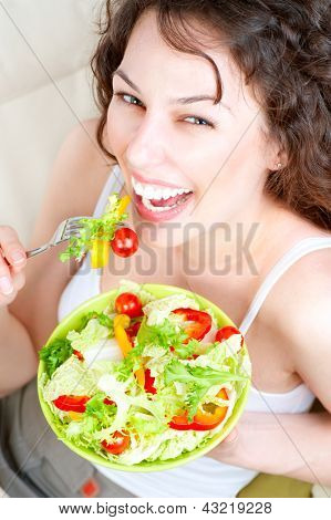 Diet concept. Healthy Food. Dieting. Beautiful Young Woman Eating Vegetable Salad