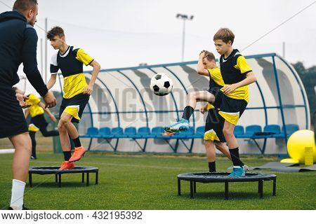 Football Club Players On Training Unit. Boys Running Fast On Soccer Practice. Coach Coaching Youth F