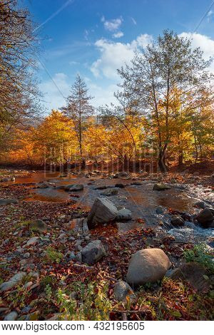 Autumn Landscape With River. Beautiful Countryside Scenery At Sunrise. Stones In The Water And Trees