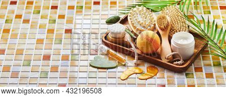Jars Of Cream For Face And Body Care, Gold Eye Patches And Serum With Gold, Jade Roller Massager Gau