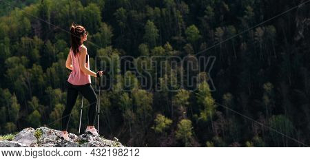 The Traveler Is Happy To Climb The Mountain. Hiking In The Mountains. Mountain Sports. The Man On Th