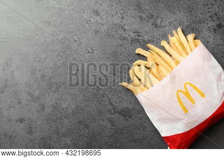 Mykolaiv, Ukraine - August 12, 2021: Small Portion Of Mcdonald's French Fries On Grey Table, Top Vie