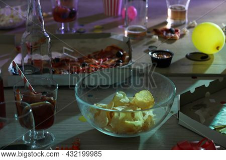 View Of Messy Table With Drinks And Leftovers After Party