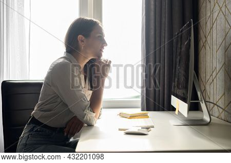 Concentrated Woman Staring At Pc Monitor, Working Remotely From Home, Focused Female Student Researc