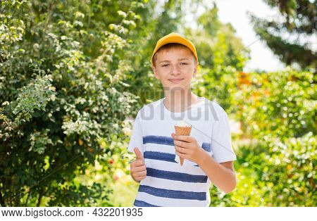 Teenage Smile Boy Showing Thumb Up Gesture And Eating Ice-cream Cone On Nature Background, Gesture C