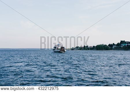 Boat In The Ocean. Lone Boat On The Horizon At Sea. Sea Voyage By Boat. Rest At The Sea. Fishing Boa