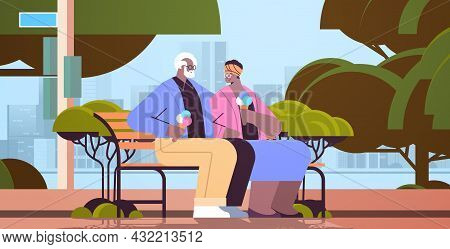 Senior Couple Sitting On Bench And Eating Ice Cream Happy African American Grandparents Spending Tim
