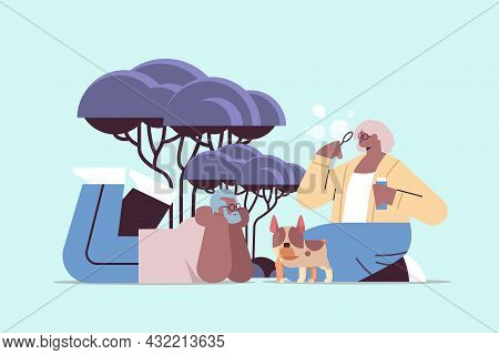 Senior African American Couple Blowing Bubbles And Spending Time With Little Dog Relaxation Retireme