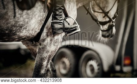 Equestrian Sport. The Leg Of The Rider In The Stirrup, Riding On A Horse. Stirrup Close-up. A Gray S