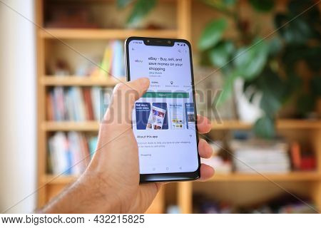 Warsaw, Poland - January 29, 2021: User Installing Ebay Auction Marketplace Mobile App On An Android