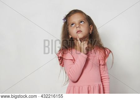 Portrait Of Cute Thoughtful Child Girl Against White Background