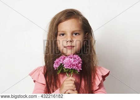 Portrait Of A Little Girl With A Flowers Bouquet