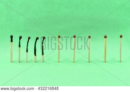 Selective Focus. Сlosely Located Matchsticks Burnt, When Safe Distancing Between Matchsticks Prevent