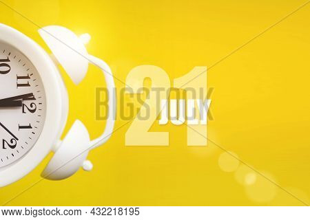 July 21st . Day 21 Of Month, Calendar Date. White Alarm Clock On Yellow Background With Calendar Day