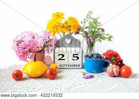 Calendar For September 25 : The Name Of The Month In English, Cubes With The Number 25, Ripe Vegetab