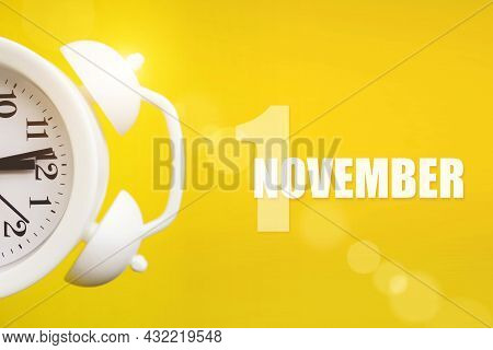 November 1st . Day 1 Of Month, Calendar Date. White Alarm Clock On Yellow Background With Calendar D