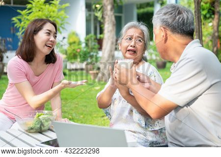 Unhappy Asian Senior Woman Anorexia And Say No To Meals, Elderly Live With Family And Caregivers Try