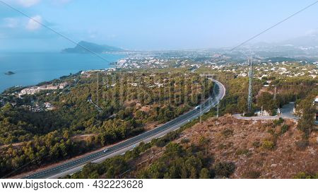 Aerial Shot Of The Coast Of Altea Hills And Mountains On The Costa Blanca Of Spain. Street With Tree