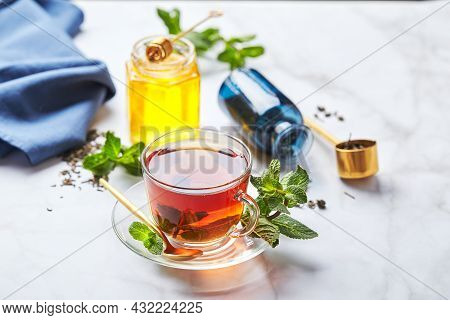 Black Tea In Glass Transparent Mug With Mint Leaves And Honey. Calming And Revitalizing Tea, Anti-st