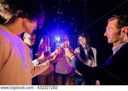 Friends At Party In Night Club Making A Clink Of Bocals Of Champagne