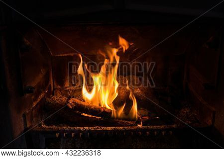 Closeup of fire burning in an old fireplace, can be used to composite in an existing image with unused fireplace
