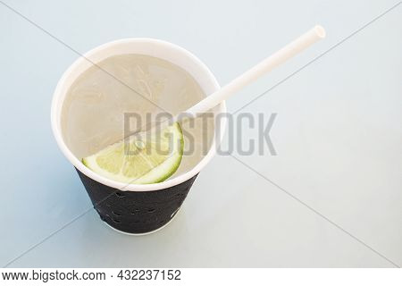 Lemon Water In A Disposable Paper Cup And Disposable Straw. Zero-waste Concept. View From Above