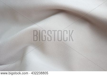 Close-up Texture Of Beige Fabric Or Cloth In Beige Color. Fabric Texture Of Beige Background. Crumpl